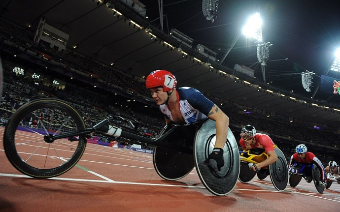 Britain's David Weir (L) competes in the men's 800m T54 final during the athletics competition at the London 2012 Paralympic Games at the Olympic Stadium in east London on September 6, 2012. AFP PHOTO / GLYN KIRKGLYN KIRK/AFP/GettyImages
